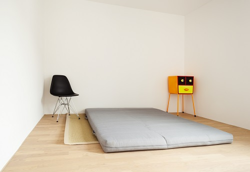 Futon lying on the floor in a flat